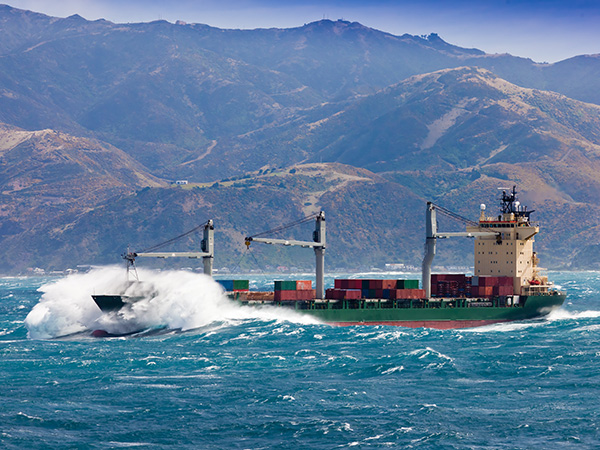 loaded-container-freight-ship-in-stormy-sea-K6B5QXP_600x450